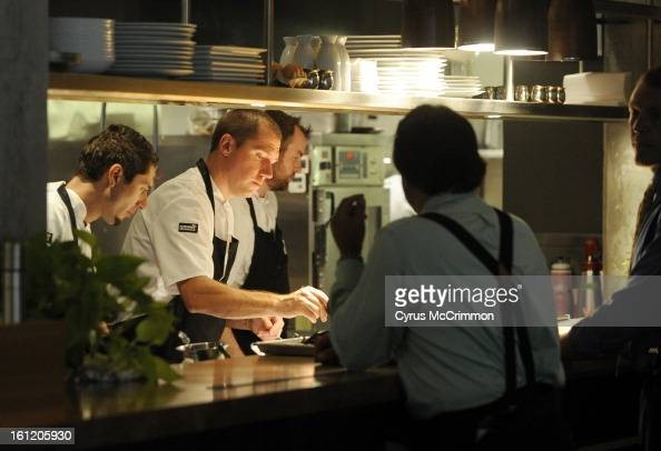 Executive Chef Max MacKissock In The Center Leads The Kitchen At - Kitchens at the denver