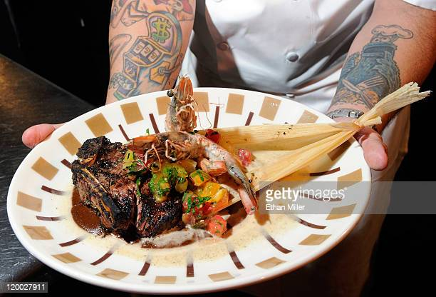 Executive chef Mike Minor displays a surf and turf dinner featuring pan seared Blue Oasis Pure Shrimp from the company's North Dakota research and...