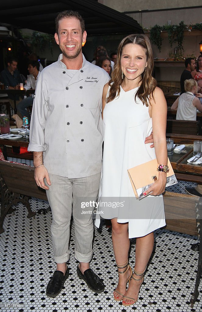 Executive Chef Seth Levine (L) and actress Sophia Bush attend Sophia Bush's Birthday Party at Hotel Chantelle on July 8, 2013 in New York City.