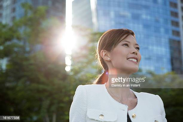 Executive  Chinese woman smiling in city