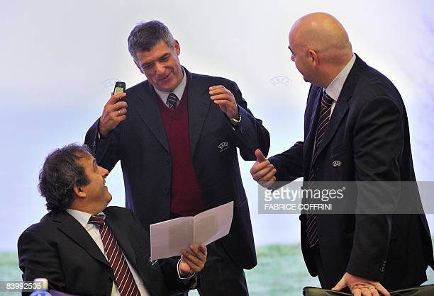 Executive Committee member Angel Maria Villar Llona of Spain gestures with UEFA President Michel Platini and deputy Chief Executive Gianni Infantino...