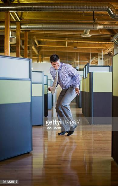 Executive dancing in the aisles of his office