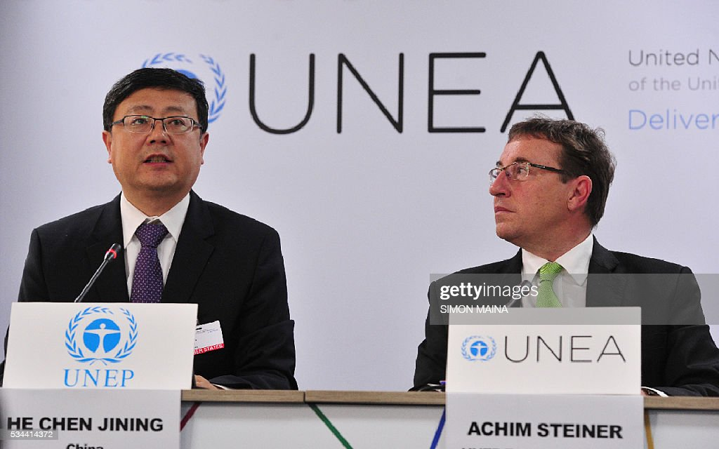 Executive Director Achim Steiner (R) listens to Chinese Environment Minister Chen Jining speaking during a press conference at the United Nation Environment Assembly (UNEA) in Nairobi on May 26, 2016 . The Assembly which represents the worlds highest-level of decision-making body on the environment will culminate in resolutions and a global call to action to address the critical environmental challenges facing the world today. / AFP / SIMON