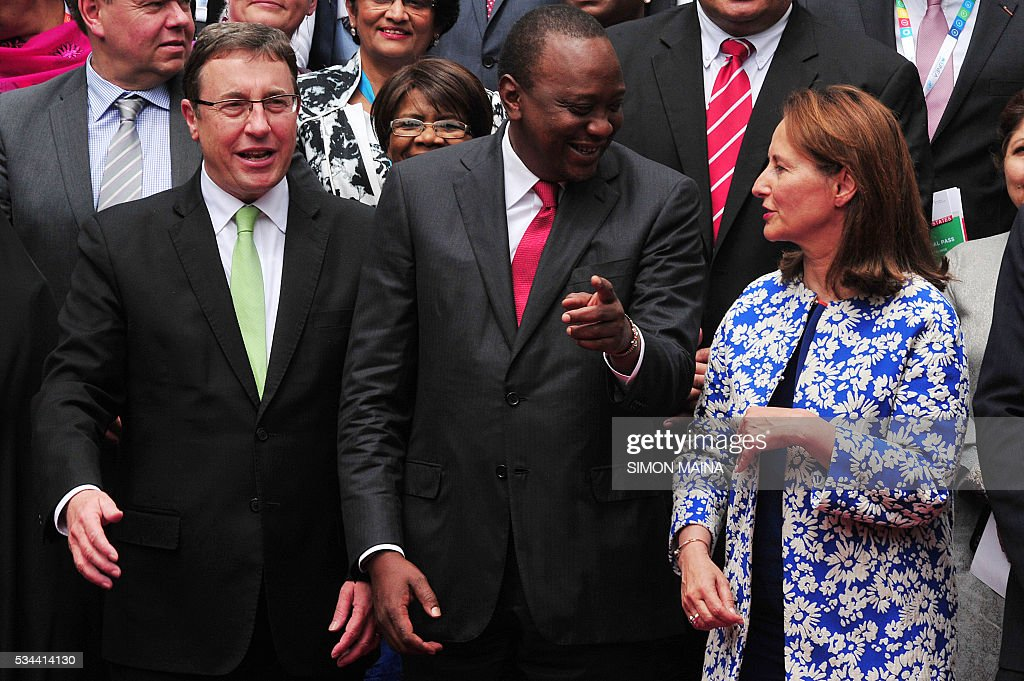 Executive Director Achim Steiner (L) looks on as Kenya President Uhuru Kenyatta (C) chats with French Minister of the Environment Marie-Ségolène Royal, during the United Nation Environment Assembly (UNEA) in Nairobi on May 26, 2016. The Assembly which represents the worlds highest-level of decision-making body on the environment will culminate in resolutions and a global call to action to address the critical environmental challenges facing the world today. / AFP / SIMON