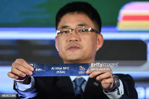 Executive Director AFC Competitions Division Shin Man Gil displays a draw for AlHilal Saudi Football Club from Saudi Arabia during the 2017 AFC...