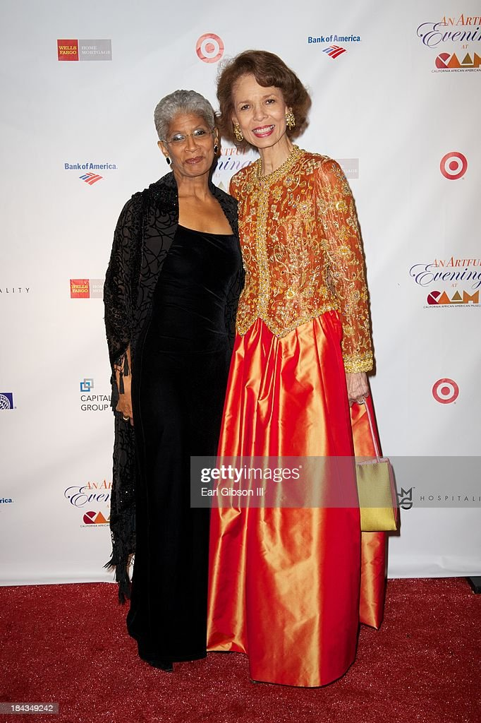 Executive Director Charmaine Jefferson and Artist Phoebe Beasley pose for a photo on the red carpet for 'An Artful Evening At CAAM' Gala at California African American Museum on October 12, 2013 in Los Angeles, California.