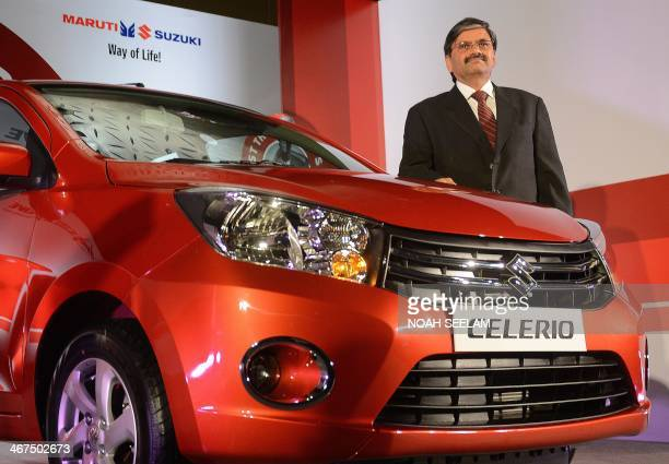 Executive Director Engineering of Maruti Suzuki India Limited CV Raman poses with a new Celerio motor car during a launch ceremony in Hyderabad on...