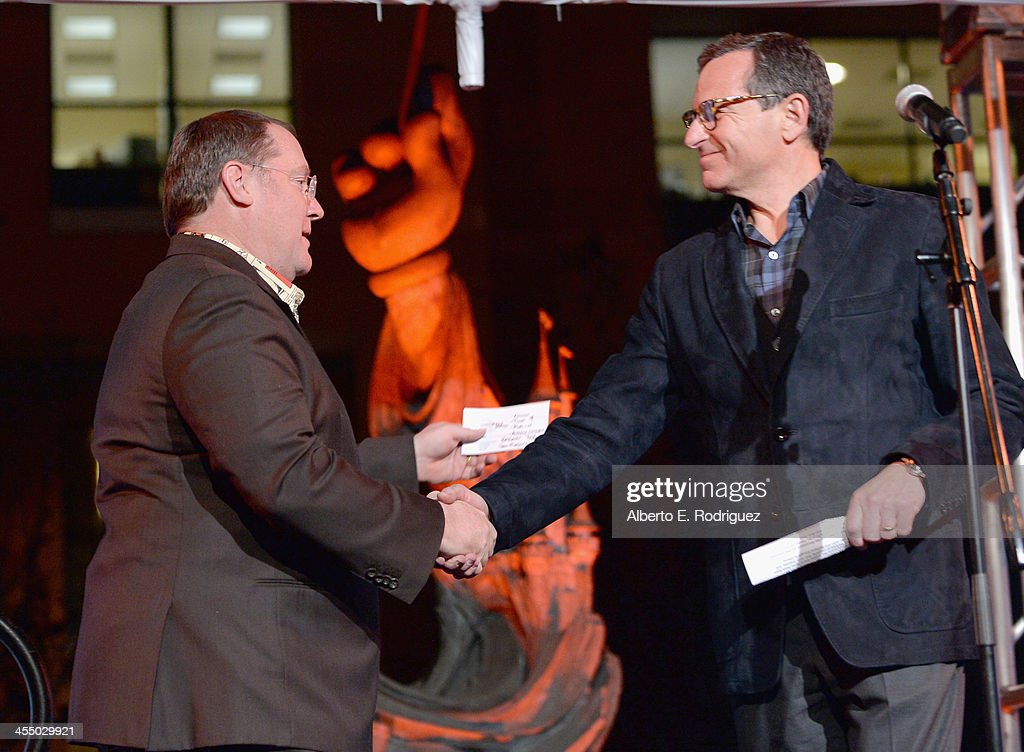 Executive director John Lasseter (L) and Chairman and Chief Executive Officer, The Walt Disney Company Bob Iger onstage during the 90 Years of Disney Animation celebration at Walt Disney Studios on December 10, 2013 in Burbank, California.