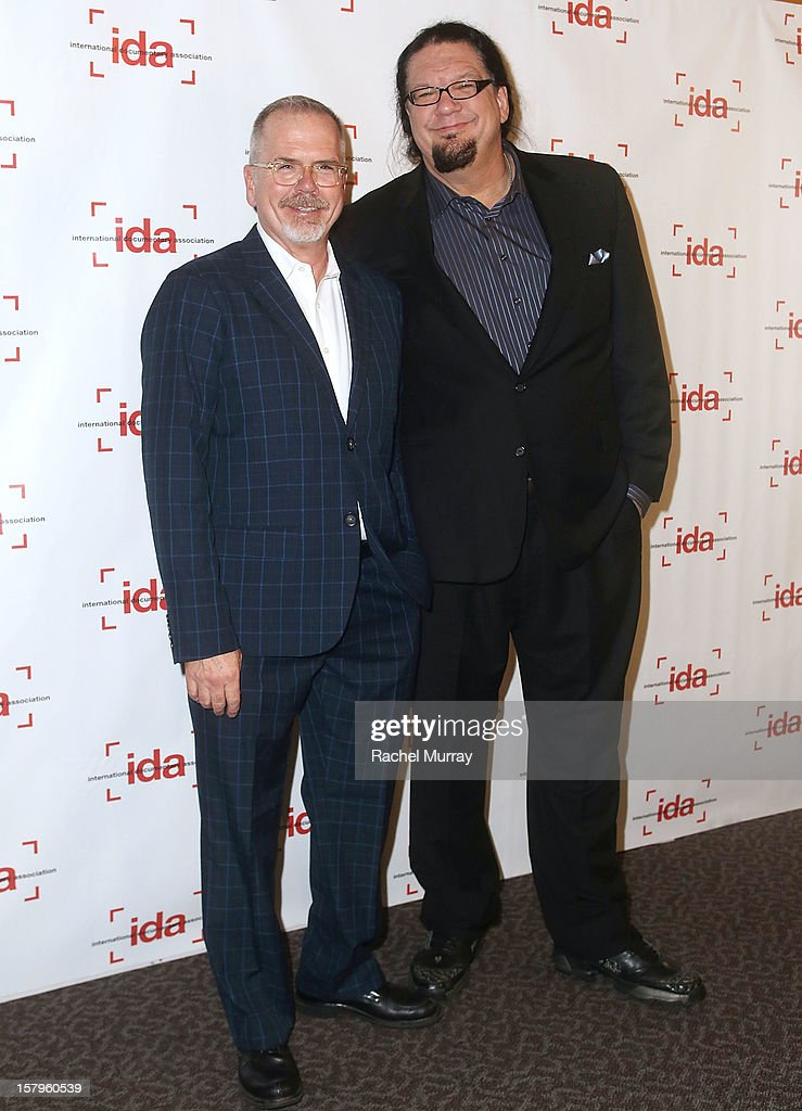 Executive Director Michael Lumpkin (L) and Host <a gi-track='captionPersonalityLinkClicked' href=/galleries/search?phrase=Penn+Jillette&family=editorial&specificpeople=547802 ng-click='$event.stopPropagation()'>Penn Jillette</a> attend the International Documentary Association's 2012 IDA Documentary Awards at DGA Theater on December 7, 2012 in Los Angeles, California.