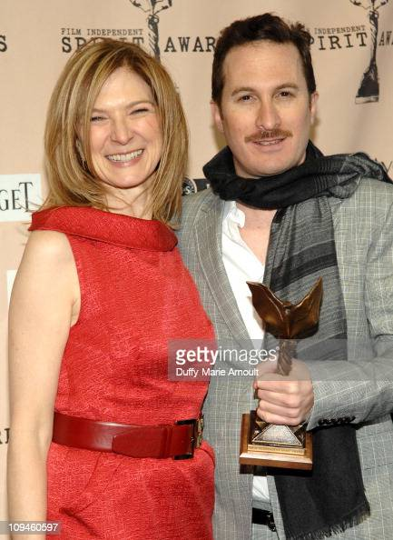 Executive Director of Film Independent Dawn Hudson and director Darren Aronofsky pose in the press room during the 2011 Film Independent Spirit...