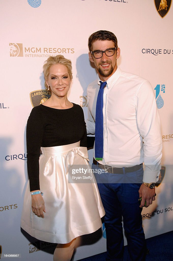 Executive Director of ONE DROP Catherine Bachand (L) and swimmer <a gi-track='captionPersonalityLinkClicked' href=/galleries/search?phrase=Michael+Phelps&family=editorial&specificpeople=162698 ng-click='$event.stopPropagation()'>Michael Phelps</a> arrive at Cirque du Soleil's 'One Night for ONE DROP' at Hyde Bellagio at the Bellagio on March 22, 2013 in Las Vegas, Nevada.