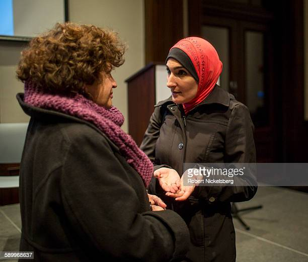 Executive Director of the ArabAmerican Association of New York Linda Sarsour speaks to an unidentified attendee during the 'Life after Surveillance...