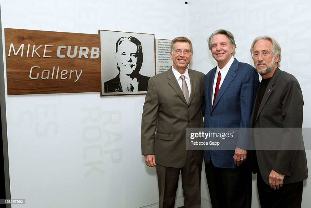 Executive director of the GRAMMY Museum Bob Santelli, musician Mike Curb, and President of the Recording Academy <a gi-track='captionPersonalityLinkClicked' href=/galleries/search?phrase=Neil+Portnow&family=editorial&specificpeople=208909 ng-click='$event.stopPropagation()'>Neil Portnow</a> at the Mike Curb Gallery Opening at The GRAMMY Museum on March 7, 2013 in Los Angeles, California.