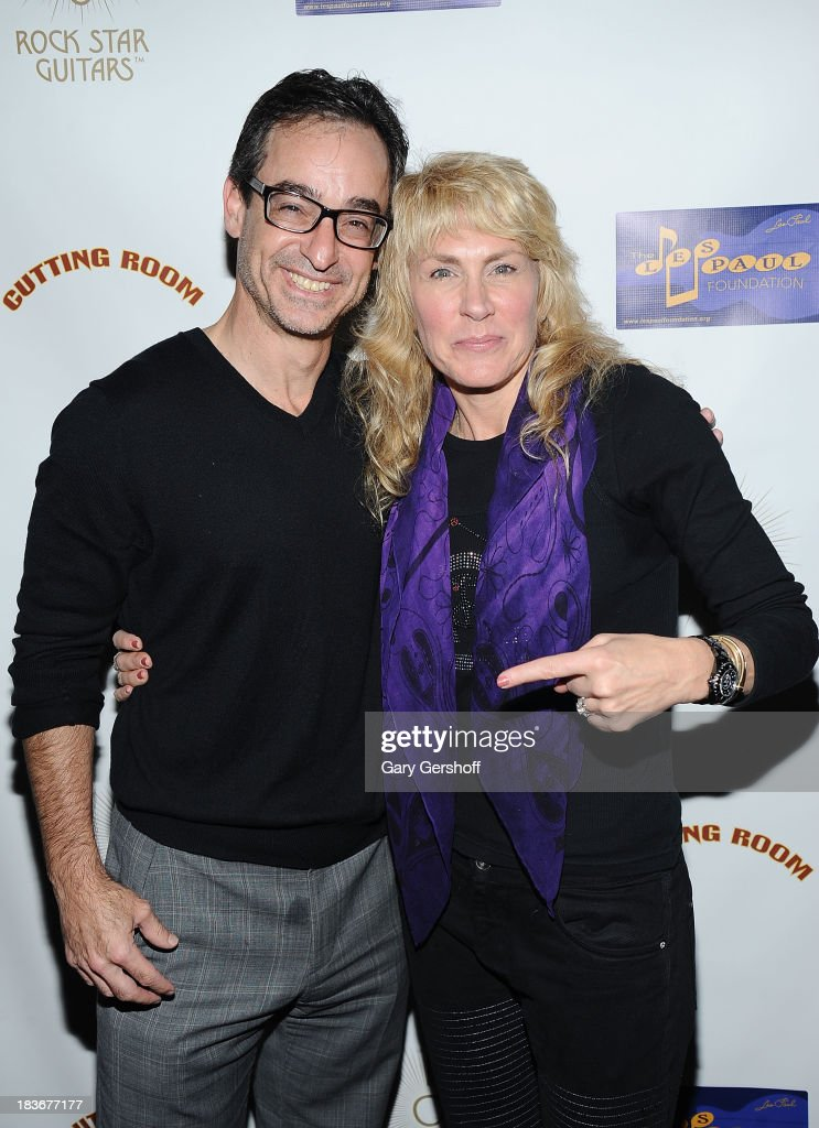 Executive Director of The Les Paul Foundation, Michael Braunstein (L) and author and photographer Lisa Johnson attend the book launch and performance for '108 Rock Star Guitars' benefitting The Les Paul Foundation at The Cutting Room on October 8, 2013 in New York City.