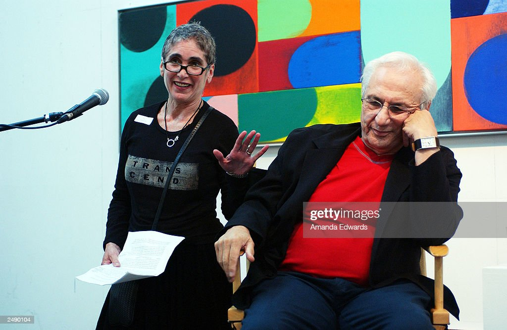 Executive Director of the Santa Monica Museum of Art Elsa Longhauser teases architect Frank Gehry at the Santa Monica Museum of Art's Party with Frank Gehry at Chuck Arnoldi's art studio on September 12, 2003 in Venice, California.