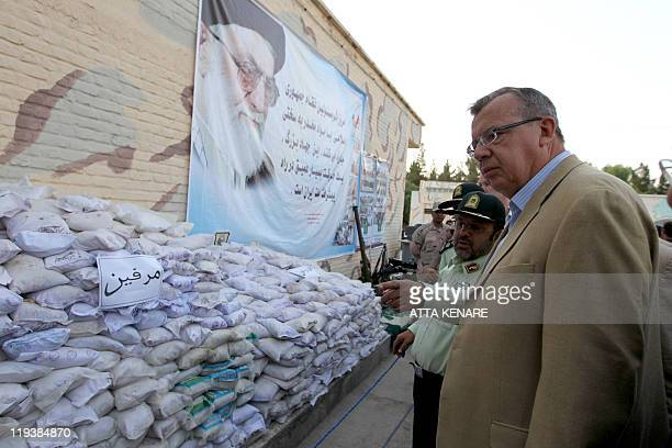 Executive director of the UN office on drugs and crime Yury Fedotov and Iranian antinarcotics police chief Hamidreza Housein Abadi look at bags of...