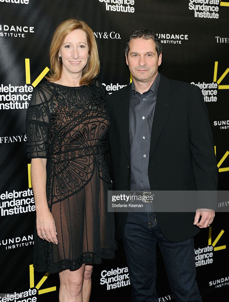 Executive Director, Sundance Institute Keri Putnam (L) and writer Scott Frank arrive at the Sundance Institute Benefit presented by Tiffany & Co. in Los Angeles held at Soho House on June 6, 2012 in West Hollywood, California.