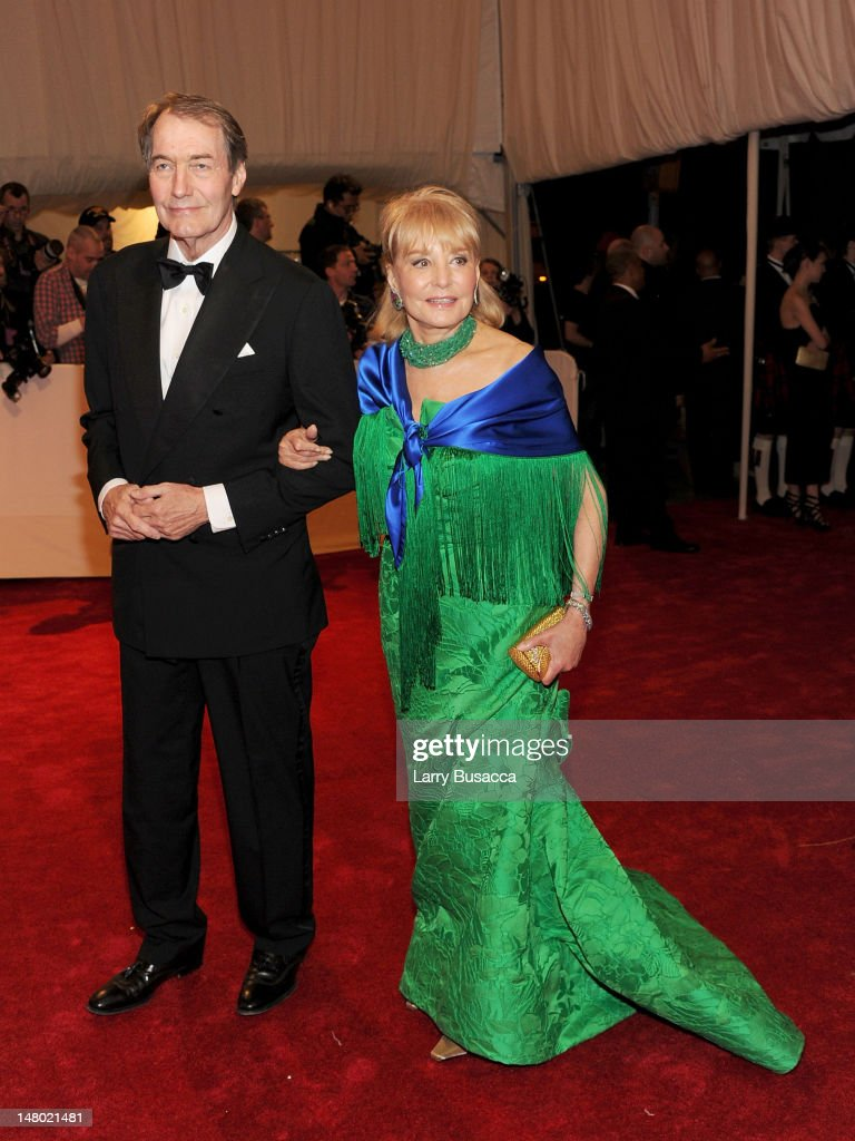 Executive editor/anchor Charlie Rose and Barbara Walters attend the 'Alexander McQueen: Savage Beauty' Costume Institute Gala at The Metropolitan Museum of Art on May 2, 2011 in New York City.