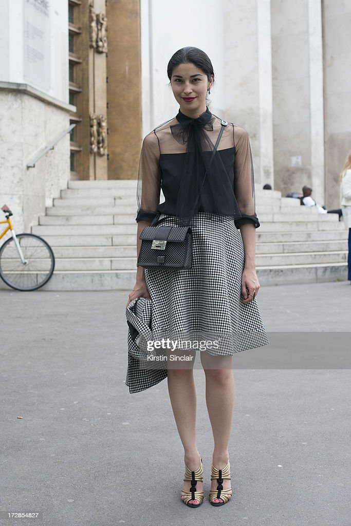 Executive fashion director of Tank Issa Caroline Issa wears a Jimmy Choo bag, Bouchra Jarrar jacket and skirt, Jason Wu top and Lara Bohinc shoes on day 2 of Paris Collections: Womens Haute Couture on July 02, 2013 in Paris, France.
