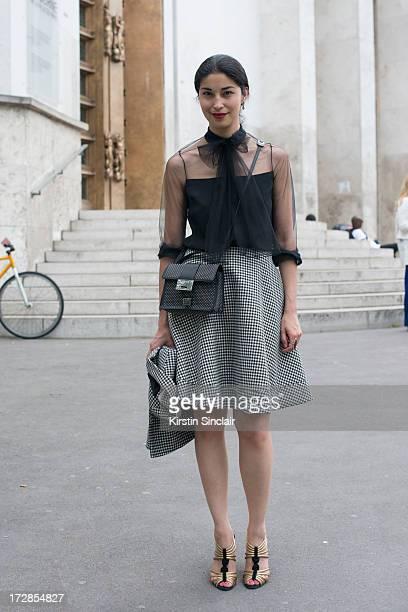 Executive fashion director of Tank Issa Caroline Issa wears a Jimmy Choo bag Bouchra Jarrar jacket and skirt Jason Wu top and Lara Bohinc shoes on...