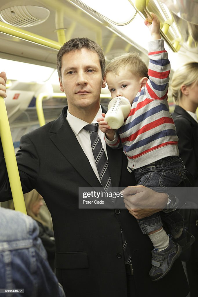 executive father on tube with baby : Stock Photo
