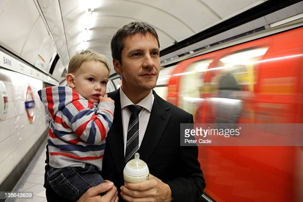executive father waiting for tube with baby