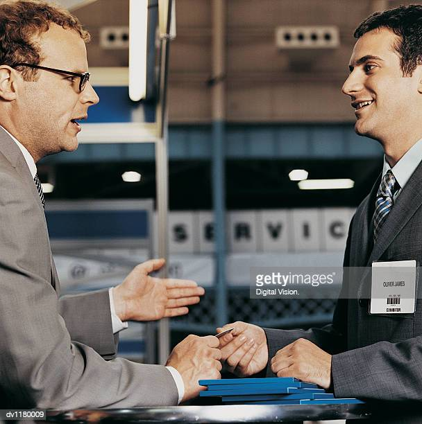 Executive Giving Another Businessman a Business Card at a Conference