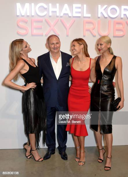 Executive Group President of The EstŽe Lauder Companies Inc John Demsey with Martha Hunt Edita Vilkeviciute and Soo Joo at the Michael Kors Sexy Ruby...