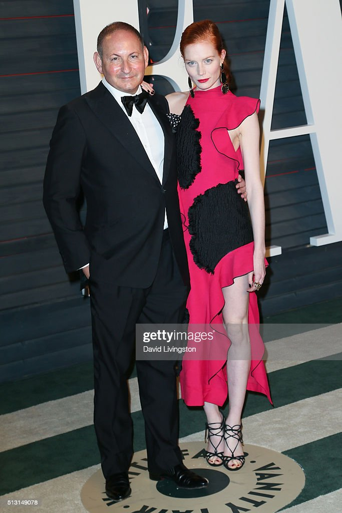 Executive Group President The Estee Lauder Companies Inc John Demsey and actress Jessica Joffe arrive at the 2016 Vanity Fair Oscar Party Hosted by...