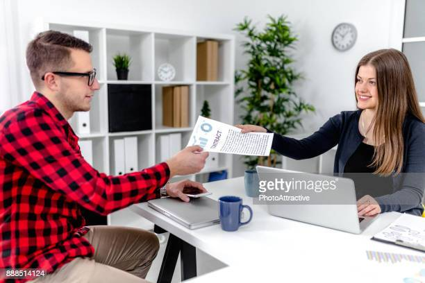 Executive hands indicating where to sign contrac