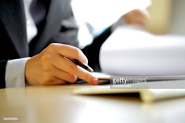 Executive man writing documents