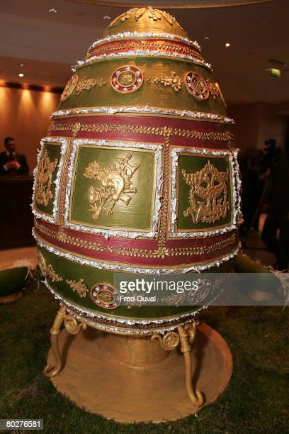 Executive Pastry Chef Beate Woellstein stands by the Faberge egg created in chocolate at the Grosvenor House on March 17 2008 in London The chocolate...