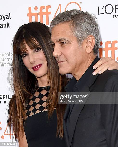 Executive Producer and actress Sandra Bullock and producer George Clooney attend the 'Our Brand is Crisis' premiere during the 2015 Toronto...