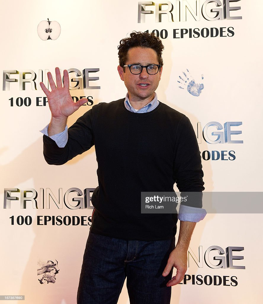 Executive Producer and Creator <a gi-track='captionPersonalityLinkClicked' href=/galleries/search?phrase=J.J.+Abrams&family=editorial&specificpeople=253632 ng-click='$event.stopPropagation()'>J.J. Abrams</a> waves to photographers on the red carpet while attending 'Fringe' celebrates 100 episodes and final season at Fairmont Pacific Rim on December 1, 2012 in Vancouver, Canada.