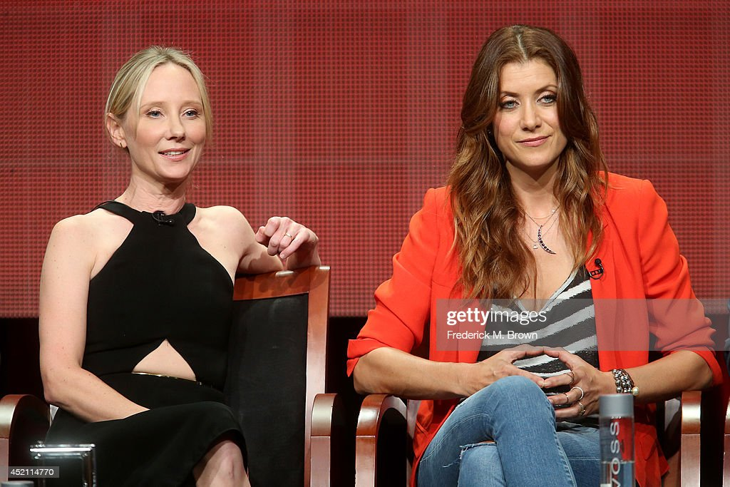Executive producer Anne Heche and actress Kate Walsh speak onstage at the 'Bad Judge' panel during the NBCUniversal portion of the 2014 Summer Television Critics Association at The Beverly Hilton Hotel on July 13, 2014 in Beverly Hills, California.