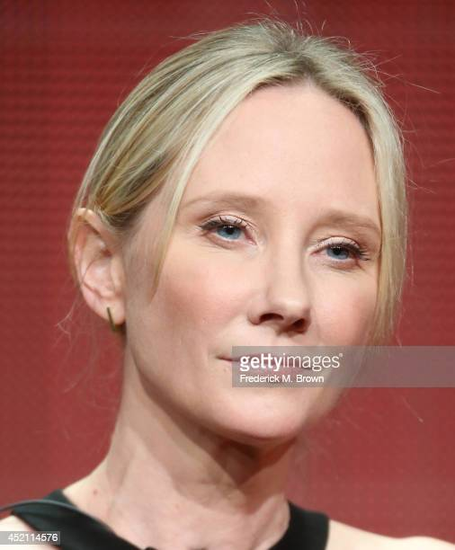Executive producer Anne Heche speaks onstage at the 'Bad Judge' panel during the NBCUniversal portion of the 2014 Summer Television Critics...