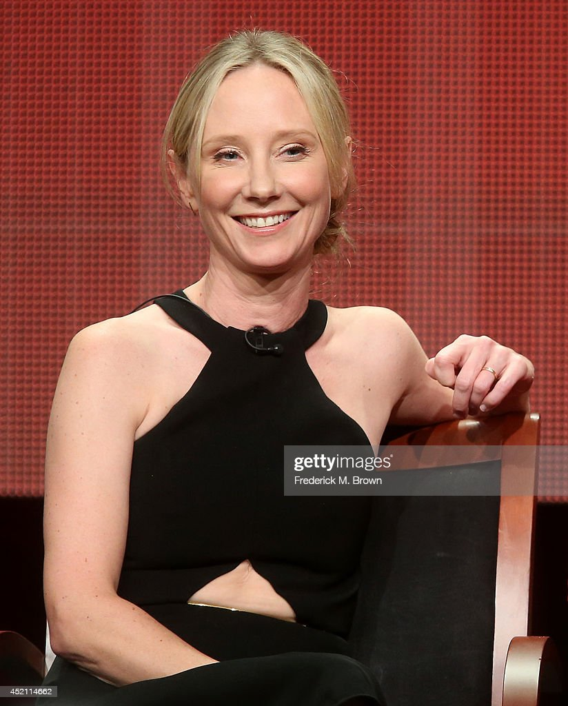 Executive producer <a gi-track='captionPersonalityLinkClicked' href=/galleries/search?phrase=Anne+Heche&family=editorial&specificpeople=202988 ng-click='$event.stopPropagation()'>Anne Heche</a> speaks onstage at the 'Bad Judge' panel during the NBCUniversal portion of the 2014 Summer Television Critics Association at The Beverly Hilton Hotel on July 13, 2014 in Beverly Hills, California.