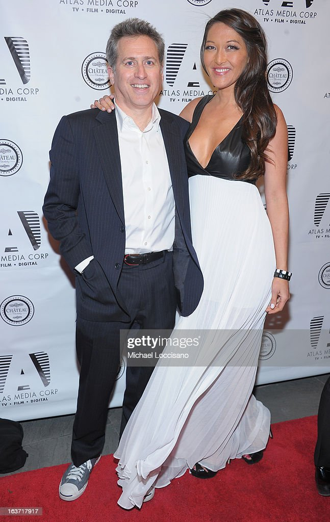 Executive Producer Bruce David Klein and castmember Candice Kumai attend the 'Playing With Fire' premiere at Chateau Cherbuliez on March 14, 2013 in New York City.