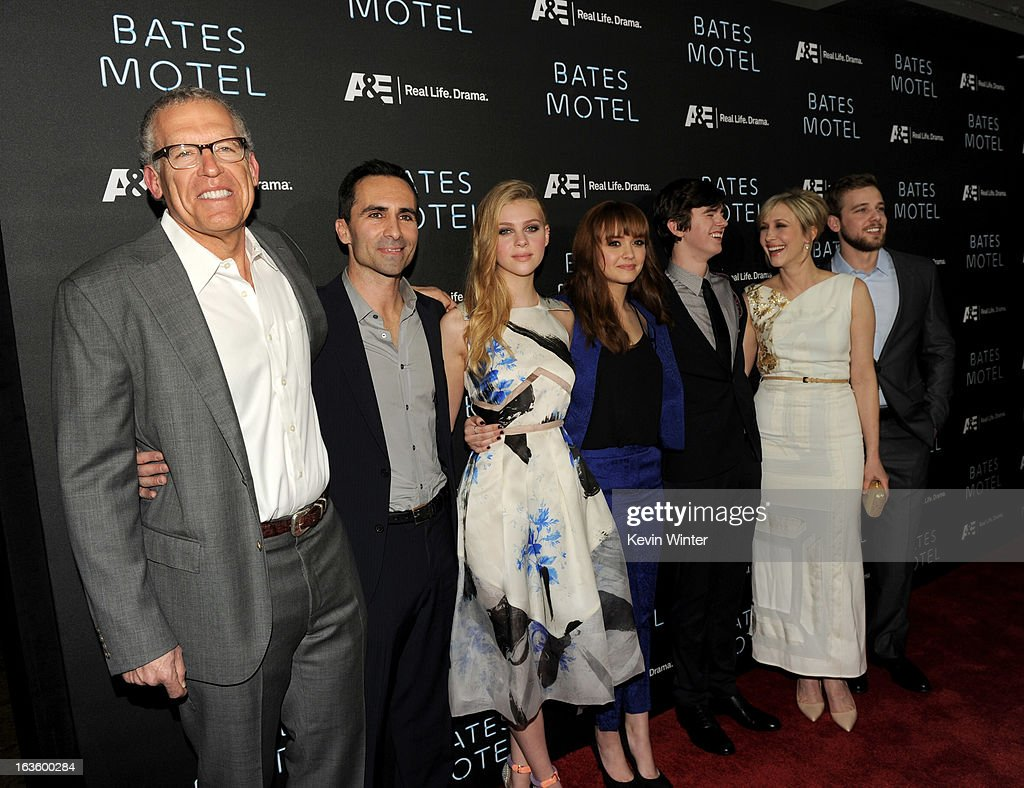 Executive Producer Carlton Cuse, actors Nestor Carbonell, Nicola Peltz, Olivia Cooke, Freddie Highmore, Vera Farmiga and Max Thieriot arrive at the premiere of A&E Network's 'Bates Motel' at Soho House on March 12, 2013 in West Hollywood, California.