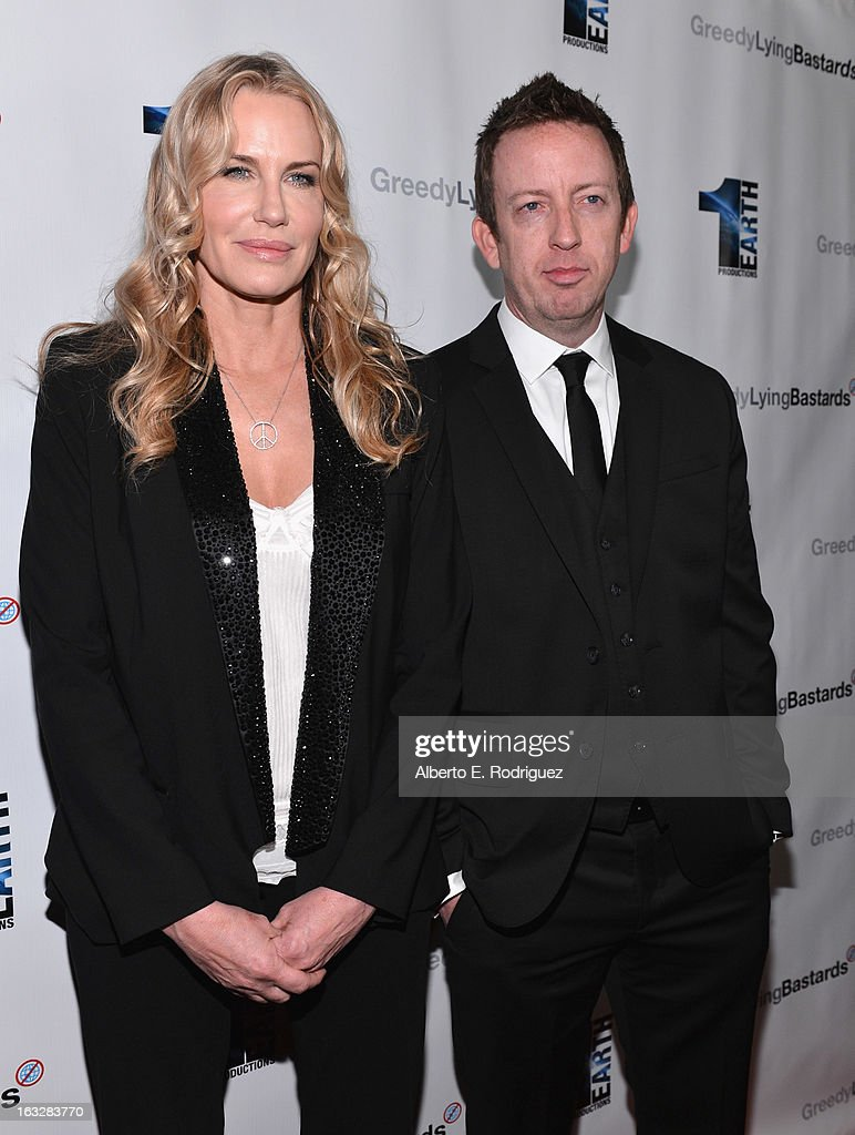 Executive producer Daryl Hannah and director/writer Craig Scott Rosenbraugh attend a screening of 1 Earth Productions' 'Greedy Lying Bastards' at Harmony Gold Theatre on March 6, 2013 in Los Angeles, California.