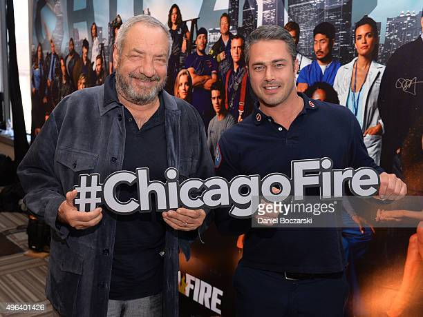 Executive Producer Dick Wolf and actor Taylor Kinney pose with a #ChicagoFire hashtag at a press junket for NBC's 'Chicago Fire' 'Chicago PD' and...