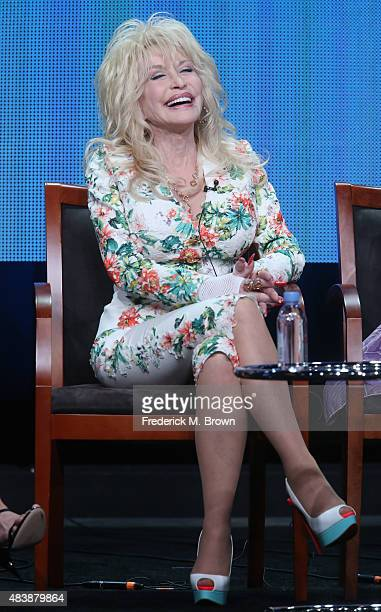 Executive producer Dolly Parton speaks onstage during NBC's 'Dolly Parton's Coat of Many Colors' panel discussion at the NBCUniversal portion of the...