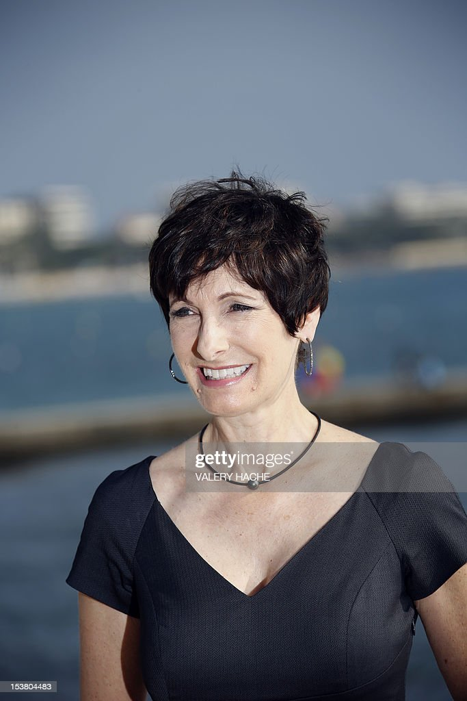 US executive producer Gale Anne Hurd poses during a photocall for the TV show 'The Walking Dead' as part of the Mipcom international audiovisual trade show at the Palais des Festivals, in Cannes, southeastern France, on October 9, 2012. AFP PHOTO / VALERY HACHE
