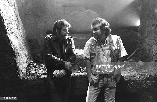 Executive producer George Lucas and director Steven Spielberg on the set of the film 'Indiana Jones and the Last Crusade' 1989 Presumably in the set...