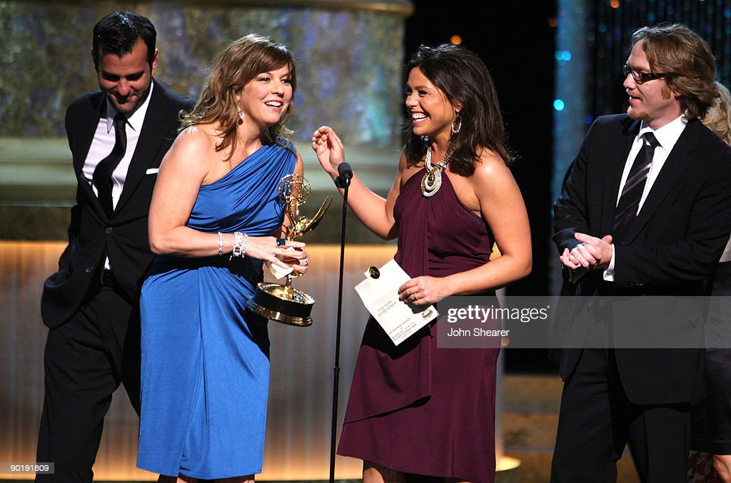 Executive Producer Janet Annino (C) and TV Personality Rachael Ray (R) accept the Emmy for Outstanding Talk Show/Entertainment during the 36th Annual Daytime Emmy Awards at The Orpheum Theatre on August 30, 2009 in Los Angeles, California.