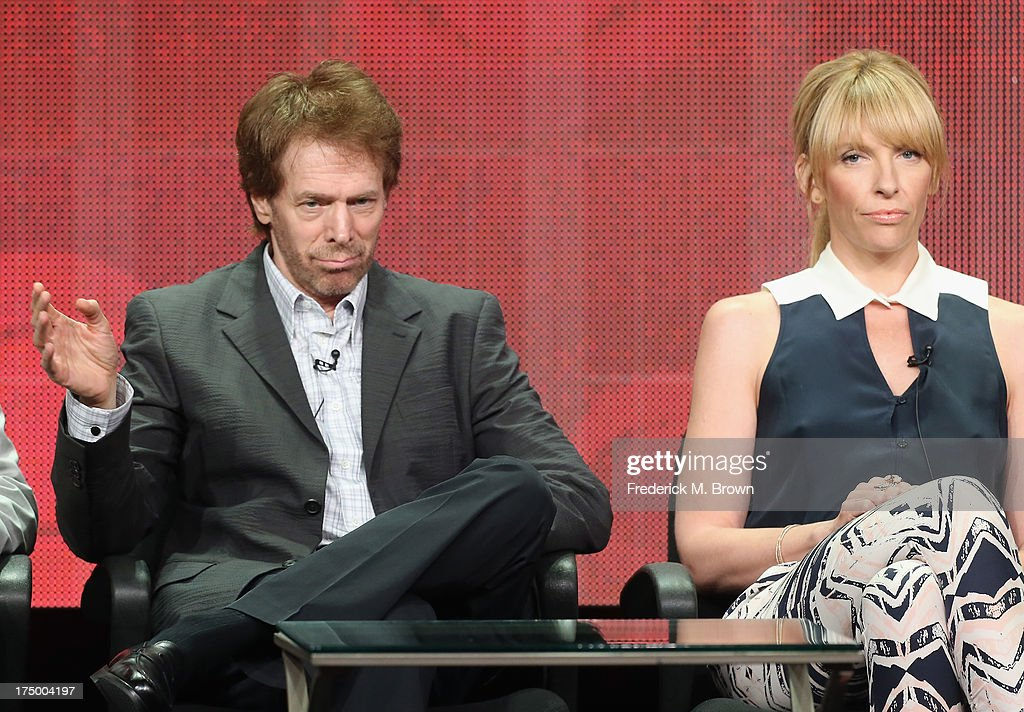 Executive producer Jerry Bruckheimer and actress Toni Collette speak onstage during the 'Hostages' panel discussion at the CBS, Showtime and The CW portion of the 2013 Summer Television Critics Association tour at the Beverly Hilton Hotel on July 29, 2013 in Beverly Hills, California.