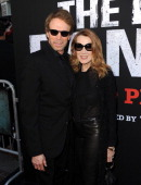 Executive producer Jerry Bruckheimer and wife Linda Bruckheimer arrive at the premiere of Walt Disney Pictures' 'The Lone Ranger' at Disney...