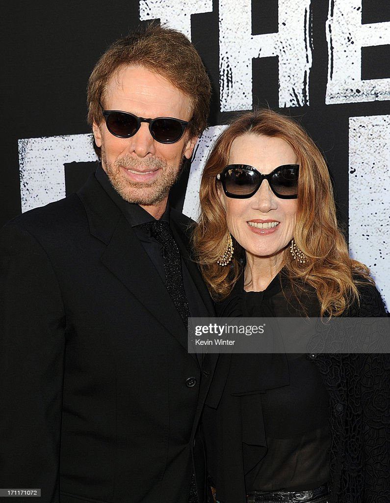 Executive producer Jerry Bruckheimer (L) and wife Linda Bruckheimer arrive at the premiere of Walt Disney Pictures' 'The Lone Ranger' at Disney California Adventure Park on June 22, 2013 in Anaheim, California.