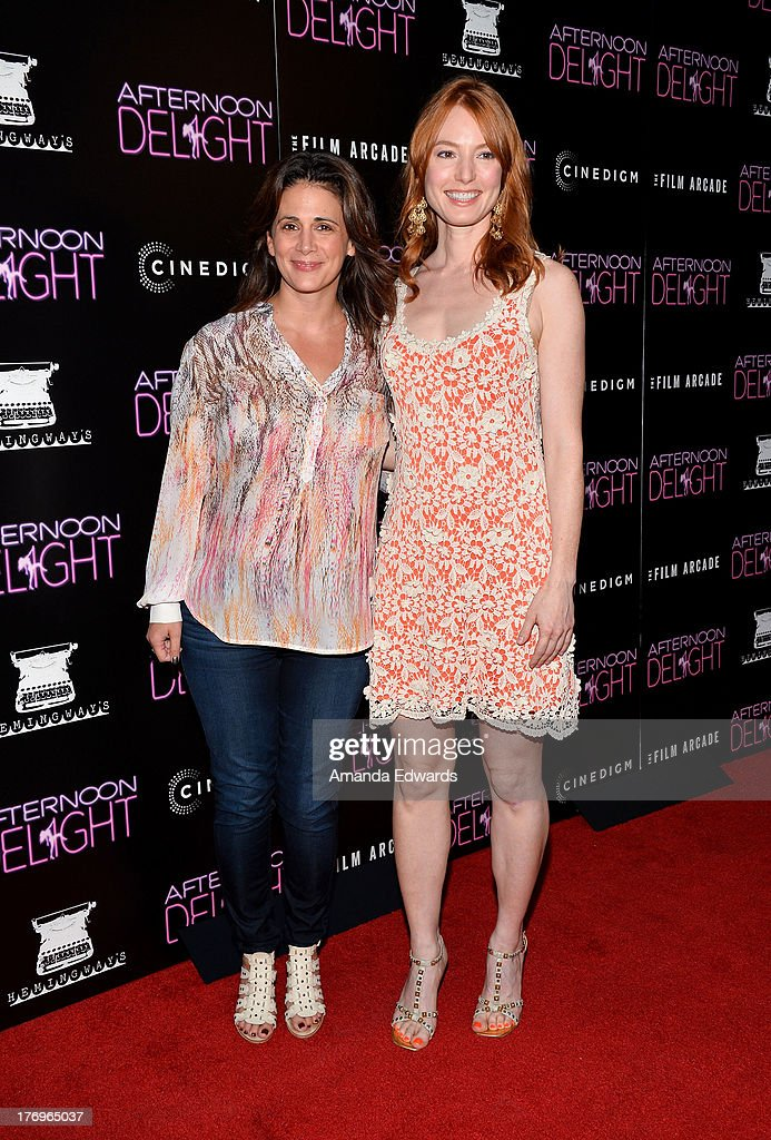 Executive producer Jessika Borsiczky (L) and actress Alicia Witt arrive at the Los Angeles premiere of 'Afternoon Delight' at ArcLight Hollywood on August 19, 2013 in Hollywood, California.