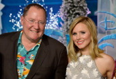 Executive Producer John Lasseter and actress Kristen Bell attend the premiere of Walt Disney Animation Studios' 'Frozen'at the El Capitan Theatre on...